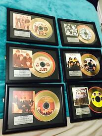 The beatles cd's in frames