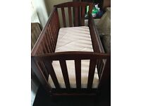 Cot for sale in brown .