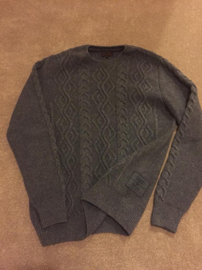 Grey knit Barbour roundneck jumper.