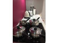 Set of 4 Presige stainless steel saucepans