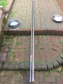 Two Metal Poles Used For Screeding