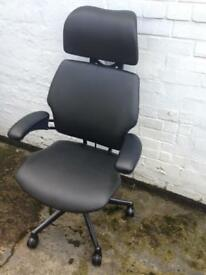 Refurbished human scale freedom chair in black leather