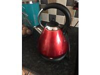 Red microwave, kettle and accessories
