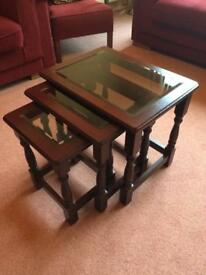 Nest of tables; mahogany and glass
