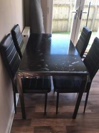 Black glass 4 chairs table