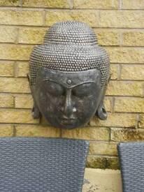 Concrete wall mounted budda heads
