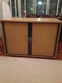 Two lovely storage cabinets with roll back doors , solid wood in great condition reduced to £30 each