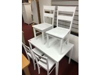 White solid wood dining table and 4 chairs