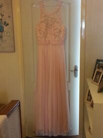 Prom/bridesmaid dress. New not worn lovely blush colour with beautiful detail on the front and back