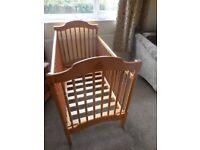 Good looking wooden baby cot