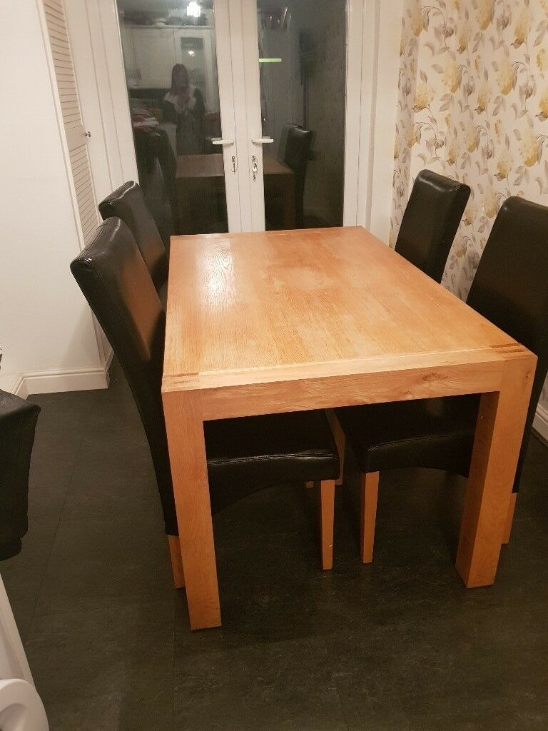 Oak Extendable Dining Table 4 8seater And Black Leather Chairs