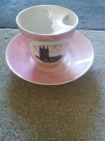 Antique Moustache cup and saucer