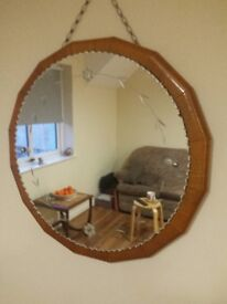 THIS IS A LOVELY ROUND MIRROR MOUNTED ON A WOODEN BASE