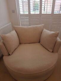 Villa Savoye cuddler swivel chair - part of the luxury House Beautiful range from DFS