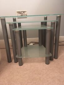 Nest of three glass tables