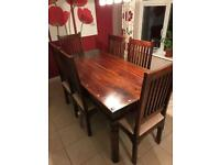 Dark wood dining table with six chairs