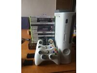 Xbox 360 60GB + 3 controllers (1 wired) + Usb charger pack + wifi adapter + 18 games