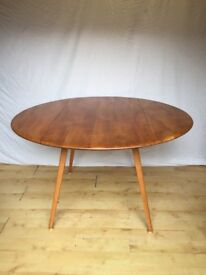 Vintage 1960s Ercol oval / round drop leaf kitchen dining table