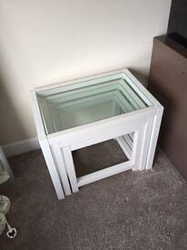 Nested side tables. white and glass.