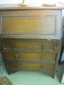 VINTAGE SOLID OAK SMALL ORNATE BUREAU - WRITING DESK. VARIOUS PIGEON HOLES & DRAWERS. VIEW/DELIVERY