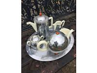 Attic find - WMF Tea & Coffee set Hammered Chrome over pottery insulated