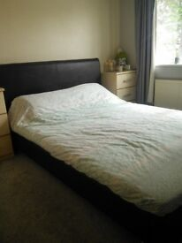 Kingsize leather bed (brown) - less than 2 years old!