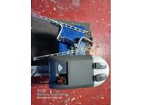 Rolux automatic garage door opener. As new with 2 remotes BARGAIN!