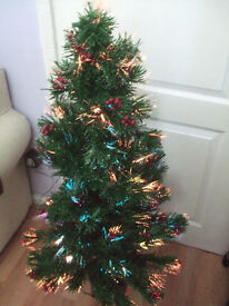 Christmas tree fibre optic tree,lovely with lots of red berries,even the star shines