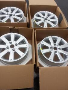 BRAND NEW NEVER MOUNTED FORD  FIESTA FACTORY OEM  15 INCH ALLOY WHEEL SET OF FOUR.  NO SENSORS.NO CENTER CAPS