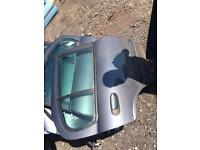Nissan Almera 2005 doors in grey