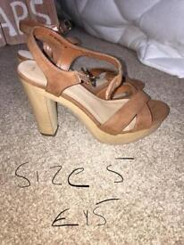 Brand new heeled strappy shoes