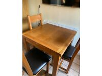 Solid wood extendable kitchen table with 4 chairs - excellent condition