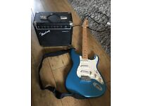 Blue AXL player delux electric guitar and mustang amplifier amp