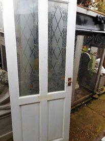 wooden door with glazing