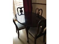 Solid mahogony extending dining table and four chairs