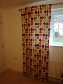 Curtain panels in spotty fabric