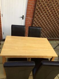 Small pine dining table and chairs for sale.