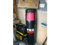 Boxing bag with wall bracket