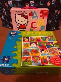 2 boxes of alphabet puzzles worth £24 altogether