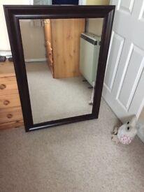 Dark wood frame wall mirror. 107cm x76cm.
