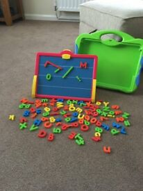 child's magnetic board with numbers and letters