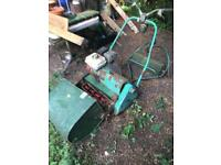 Vintage lawnmower with Honda engine