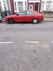nissan primera 1.6 5 doors red