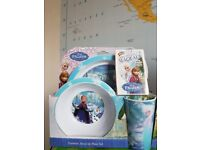 Brand New Frozen Tumbler, Bowl and Plate Set together with a new pack of Frozen Trump cards