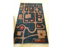 Rug with road layout for playing with cars