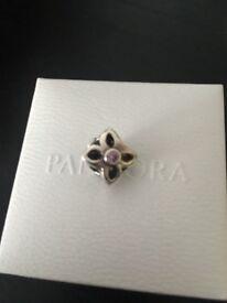 Genuine pandora flower charm with pink stone