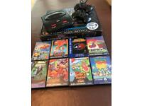 SEGA Mega Drive II with 2 control pads and 18 games