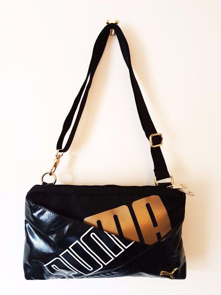 Beautiful Women's PUMA Medium Cross Body Bag. Perfect for your daily needs!