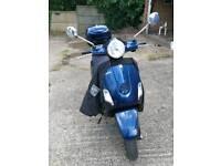 Blue Vespa LX125 Piaggio 125cc Motorcycle
