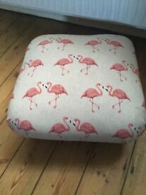Upcycled lien flamingo footstool on wheels